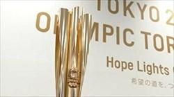 مراسم بدرقه برای دریافت مشعل المپیک در فرودگاه توکیو